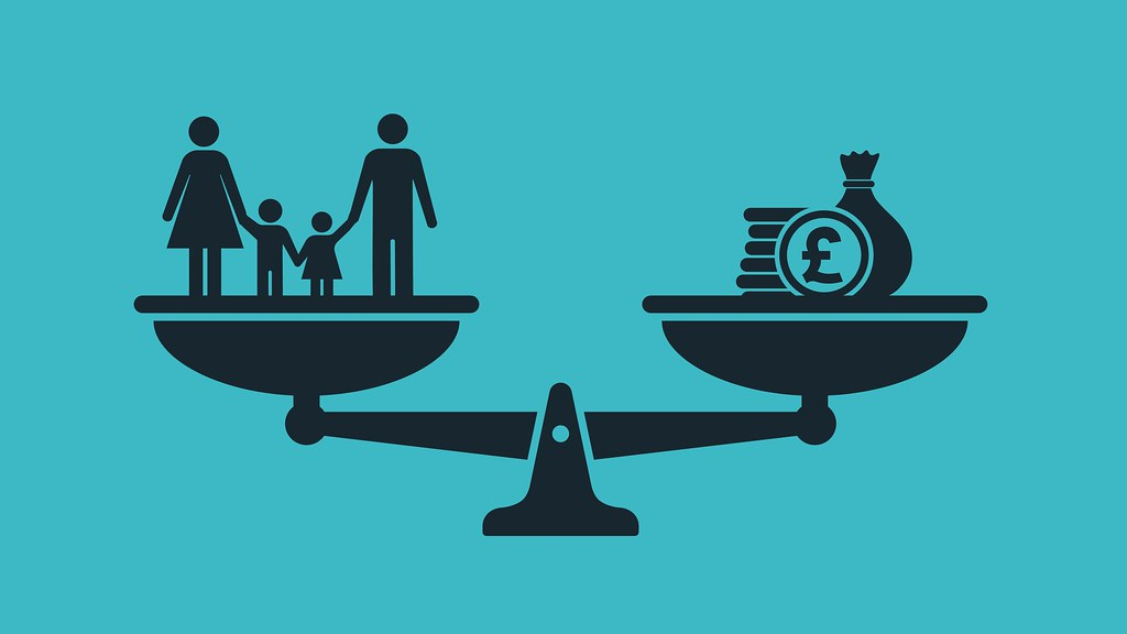 A graphic of scales balancing family and money