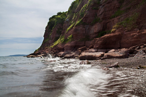 nesscove shaldon beach bay cliffs redstone erosion geology coast coastal water wave movement tripod cokin nd8filter devon uk ocean sea splash boulders rocks rugged rocky cliffface pebblebeach pebbles stones canon eos50d tamron 1750mm landscape seascape rockstriata rocklayers june summertime beachtime