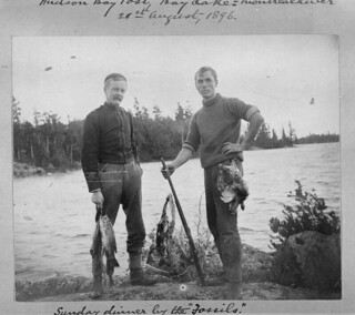 "Sunday dinner by the ""Fossils"" (left-to-right Richard Scougall Cassels and G.M. Kelley), Lady Evelyn Lake, Ontario / Souper du dimanche près des « fossiles » (à gauche, Richard Scougall Cassels; à droite, G. M. Kelley), lac Lady Evelyn (Ontario)"