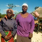 Widowed farmer Loveness Karimuno poses for a photo with her daughter