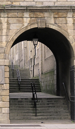 Stone staircase under an arch in a building in Dublin, Ireland