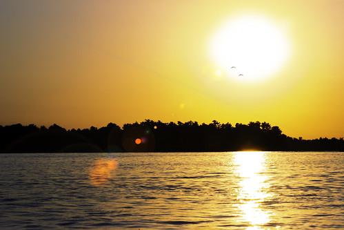 crosslake minnesota sunset lensflare lake water