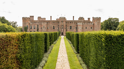 herstmonceux castle brick building architecture tower garden path paving yew hedge ornamental tree landscape grass lawn sky sussex vanishingpoint