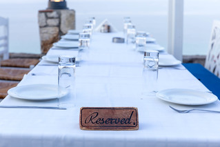 Reserved sign on a table in a Greek restaurant | by marcoverch