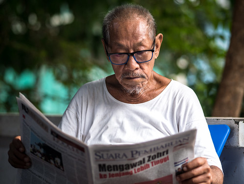 Reading Newspaper | by Henry Sudarman