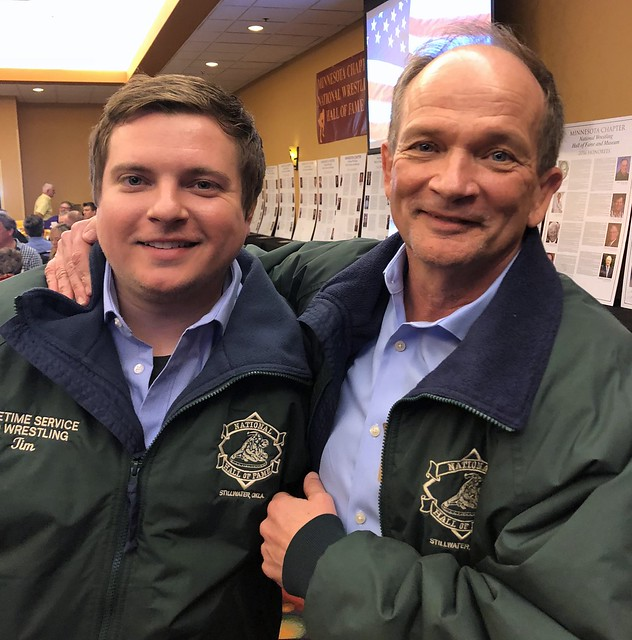 Mike Shiels representing father Tim and Tim Shiels representing late father Dick in the Parade of Green Jackets.