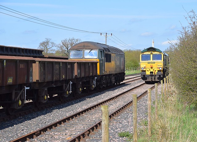 A busy scene at Foxton Exchange Sidings, as Freightliner 66548 runs around the train of spoil it has just propelled in, whilst 56303 waits to propel its train onto the mainline. 18 04 2018