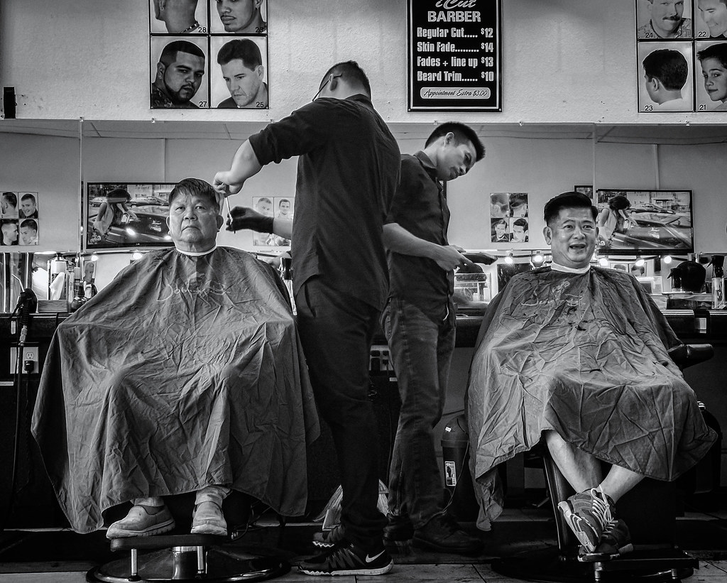 Haircuts | Two men getting their hair cut at a barbershop in… | Flickr
