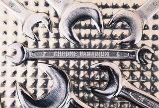 Metal Wrench on Metal Surface   by dejankrsmanovic