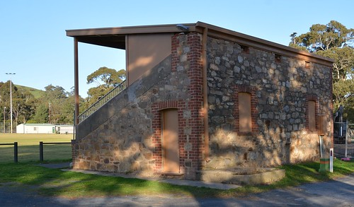 Kangarilla Recreation Grounds' pavilion of 1924 / with door and blind windows of the room beneath seating, South Australia