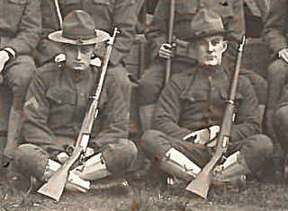 Closeup of Spruce Soldiers with Rifles