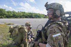 Explosive Ordnance Disposal Technician 3rd Class Devin Rodriquez, right, looks on as Senior Chief Explosive Ordnance Disposal Technician Luigi Mendoza, center, and an Australian Army soldier coordinate during Pyrocrab, Aug. 6. (U.S. Navy/MC3 Kryzentia Richards)
