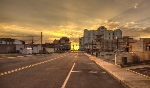 sunrise clouds vanishingpoint oceancitymd hiltonhotel sunrays sky emptystreet wideangle nikond810