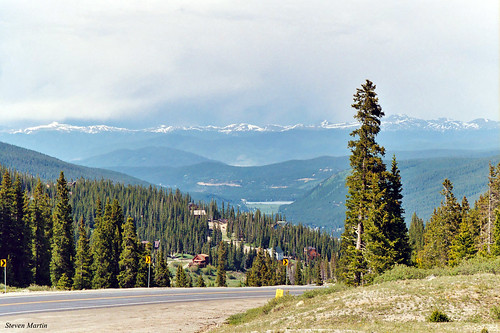 landscape scenery mountainrange mountains mountainpass valley forest trees clouds colorado unitedstates