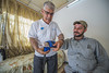 """Khalid Abdul Rahman, a physiotherapist with the EU partner Humanity & Inclusion, helps  another patient, Adil Khalid Bashir, regain mobility in his arm. Adil's hand was amputated by ISIS after he was caught trying to escape Mosul. """"If I told them that I wanted to run away they would kill me, so I said I was there to take some wheat to feed my family. Ten days later they cut my hand off.""""  © European Union 2018 (photo by Peter Biro)"""