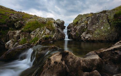 tallawatertallareservoirscottishboardersscotlandwaterfallrocksstreamlandscapeukgreatbritain