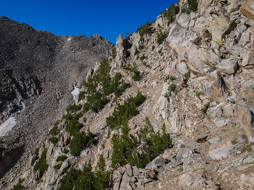 Trail is in really good shape, hugs this cliff before leveling out | by snackronym