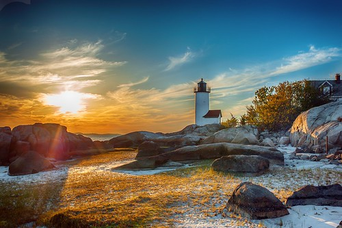 sunset lighthouse beach rocks newengland gloucester massachusetts