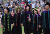 """Graduates of the William S. Richardson School of Law celebrate their achievement, joining hands and singing Hawaii Aloha at the end of the Sunday outdoor ceremony in Andrews Amphitheater on May 13, 2018. They hold roses that each is giving to also celebrate Mother's Day. Photo credit: Mike Orbito  For more photos go to: <a href=""""https://photos.app.goo.gl/Qy2YjsW6RDMxfpAf1"""" rel=""""noreferrer nofollow"""">photos.app.goo.gl/Qy2YjsW6RDMxfpAf1</a>"""