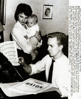 Pianist Andre de la Varre practices while family lends support, 1958 | by The Burton Holmes Archive