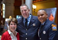 Rep. Livvy Floren with Stamford Firefighters at a reception in Hartford on May 2, 2018.