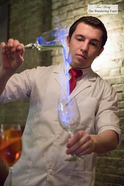 Saffron Sazerac - Whiskey, saffron elixir, house bitters, sugarcane extract, flambeed with housemade absinthe