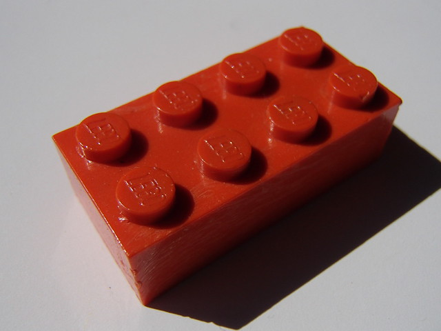 LEGO: Red Dutch G brick with stretch marks...