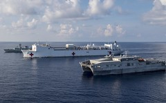 USNS Brunswick (T-EPF 6) and USNS Mercy (T-AH 19), the two primary Pacific Partnership mission platforms, sail in formation with the Royal Canadian Navy's HMCS Vancouver (FFH 331) during a passing exercise (PASSEX) in May. (U.S. Navy/MC2 Kelsey L. Adams)