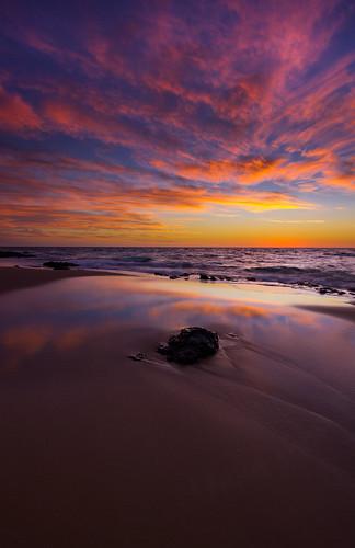 westernaustralia bunbury backbeach sunset reflections rock waves skies clouds colourful beach sand sea indianocean