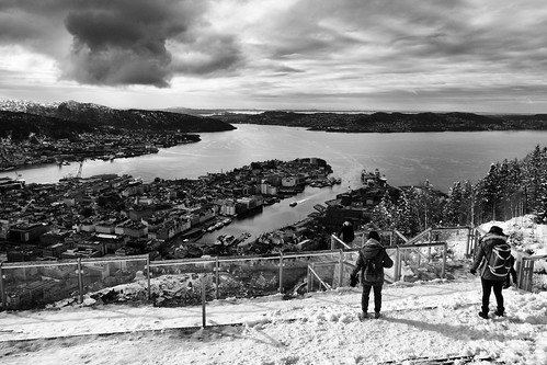 norway hordaland bergen mountfloyen funicular view fjord cityscape cloudy snow figures mountains ships boats bw