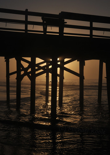 michaelkoole nikon d300 nikkor sunrise pier silhouettes waves shadows water backlit beach ocean myrtlebeach southcarolina 2885mmf3545af