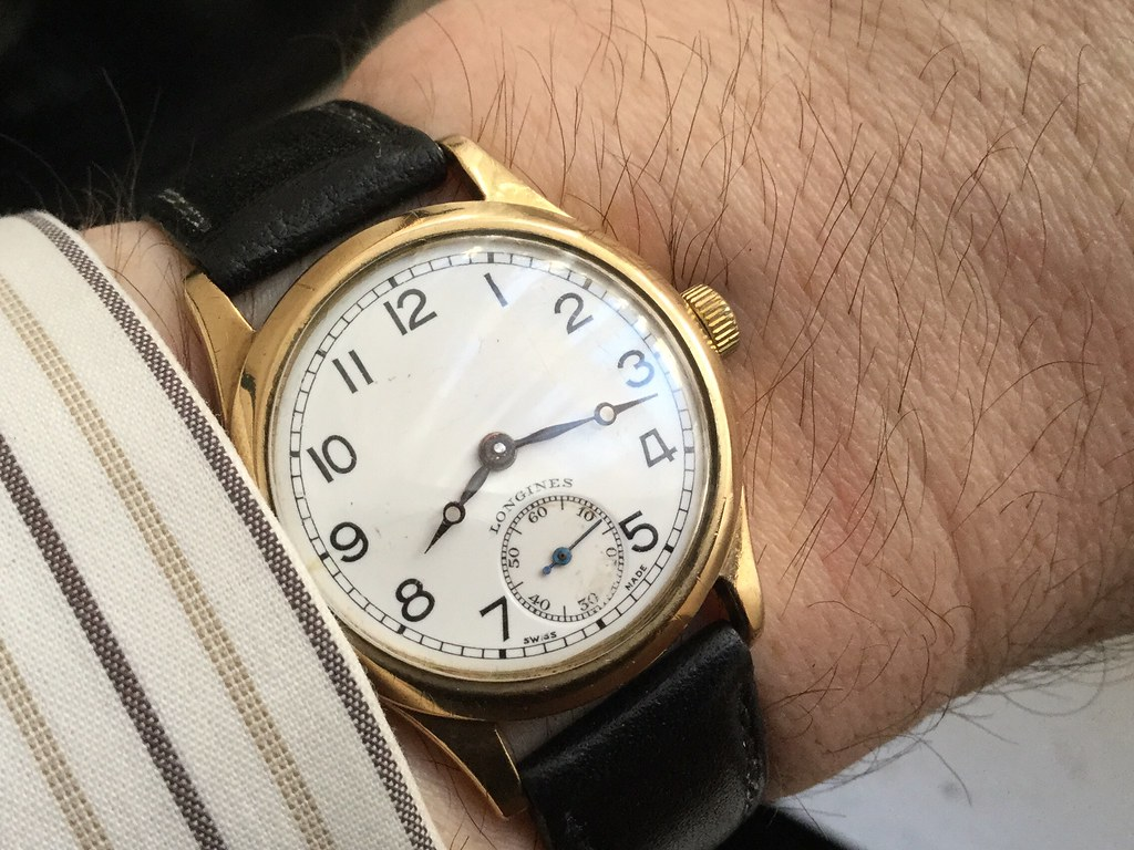9ct Longines, calibre 12.68Z, hallmarked 1945.