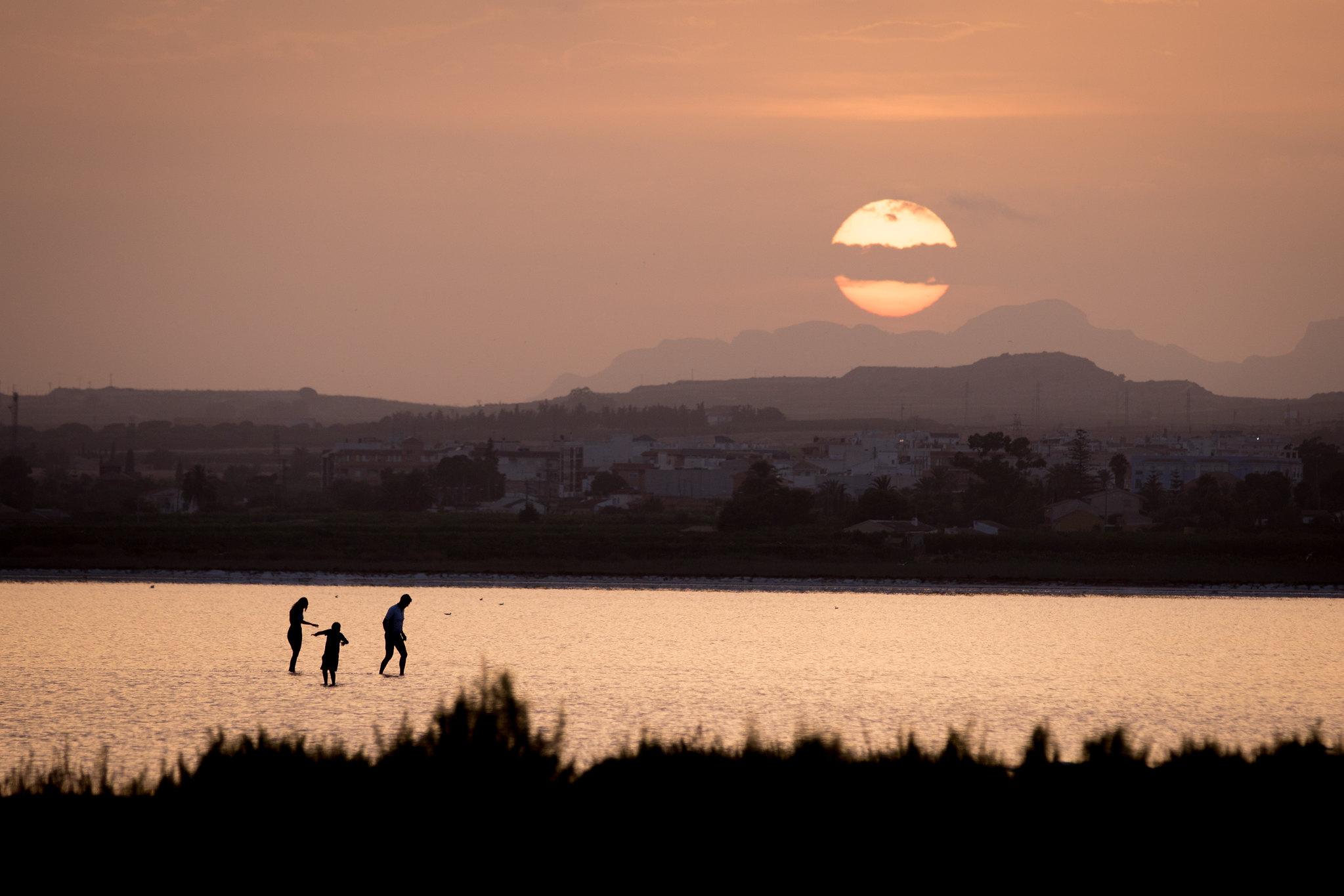 Sunset over saltlake, silhouettes