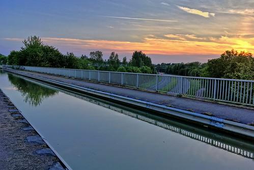 aqueduct sunset sky canal water grafton street trees clouds apple iphone se towpath milton keynes buckinghamshire bradwell reflection