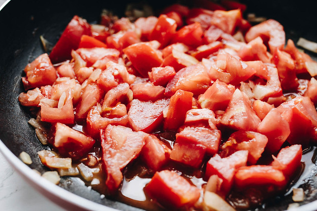 Chopped tomatoes in a pan.  Cooking tomatoes