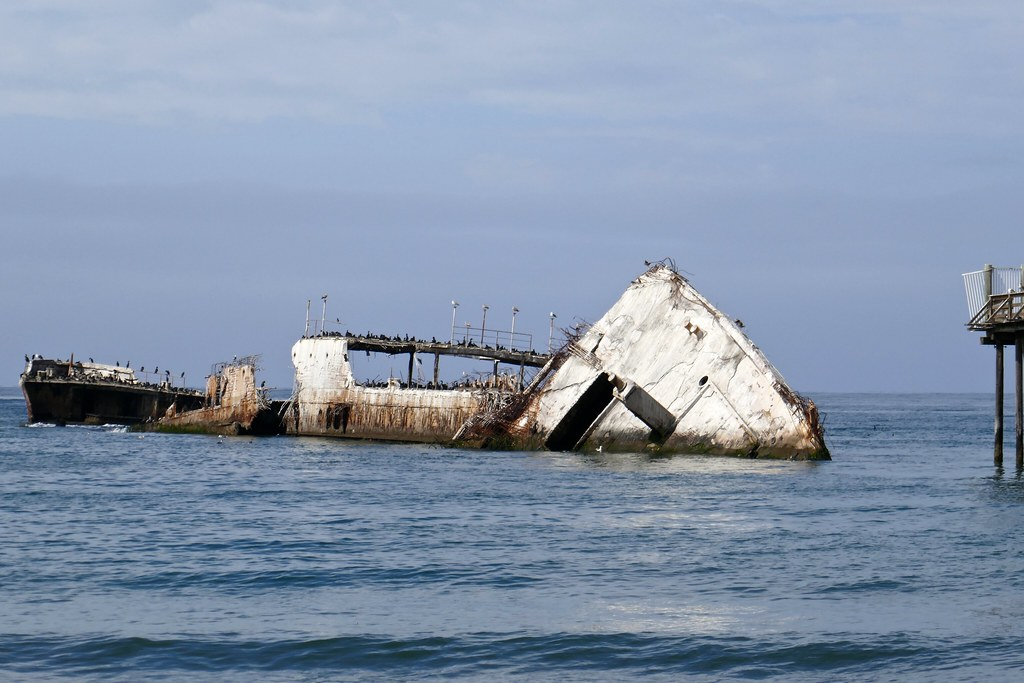 The current state of S.S. Palo Alto at the end of fishing pier at Seacliff State  Beach in Aptos