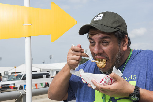 Jorge eats at Jazz Fest - boudin balls on day 5 May 4, 2018. Photo by Ryan Hodgson-Rigsbee RHRphoto.com