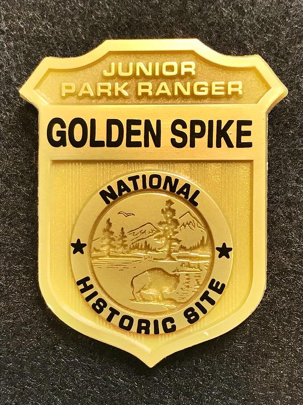 Golden spike Junior Ranger badge.