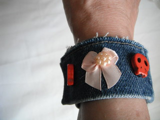 Handmade denim bracelet with skulls and bows