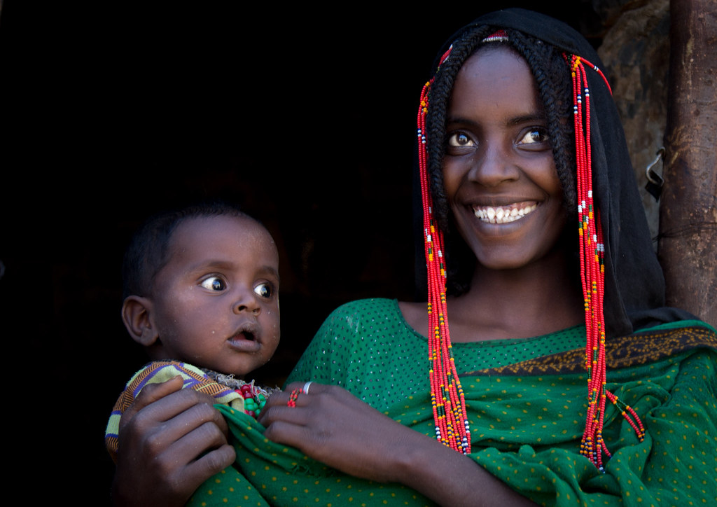 Portrait Of An Afar Tribe Woman With Braids And Beads In T Flickr