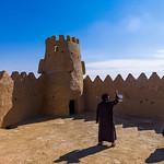 Saudi tourists taking pictures in the court of qasr zaba'al, Al-Jawf Province, Sakaka, Saudi Arabia