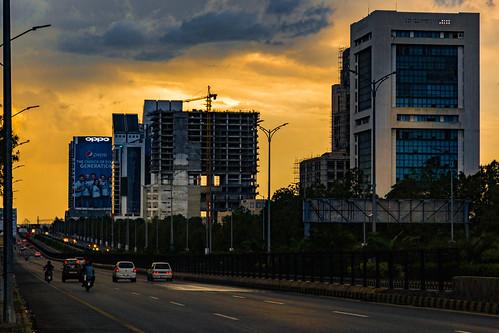 islamabad islamabadcapitalterritory pk pakistan dusk golden orange hour sunset sundown cloudscape clouds overcast skyscraper skyline cityscape urbex urban city cars road infrastructure