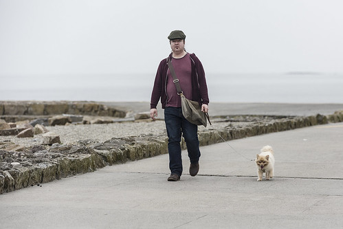 frankfullard fullard walk dog candid street portrait prom salthill galway irish ireland pet exercise outdoor seaside cap bag satchel moustache lead