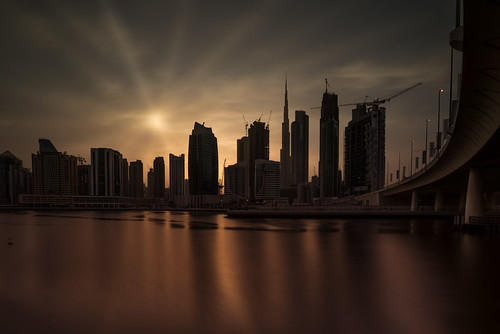 dubai united arab emirates uae brown golden hour sunset sunrays water long exposure business bay alabraj street canal reflections skyline clouds sky style processing outside day nikkor sunshine low key silhouette design architecture steel metal middle east walking view happy outdoor dxb lee little stopper nikon d810 flickr burj khalifa damac properties wide angle desert