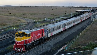 P17 departs Caroline Springs railway station in push-pull configuration with P12 hauling a Bacchus Marsh to Melbourne morning-commuter V/Line service.