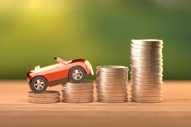 Toy car climbing increasing stacks of coins
