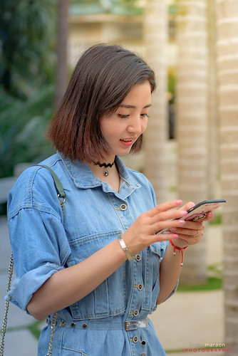 Pretty chinese girl in denim dress... | by listermaraon