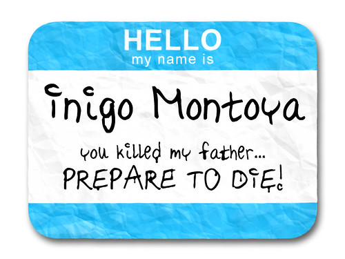 blue name tag reading Hello My Name Is Inigo Montoya you killed my father prepare to die