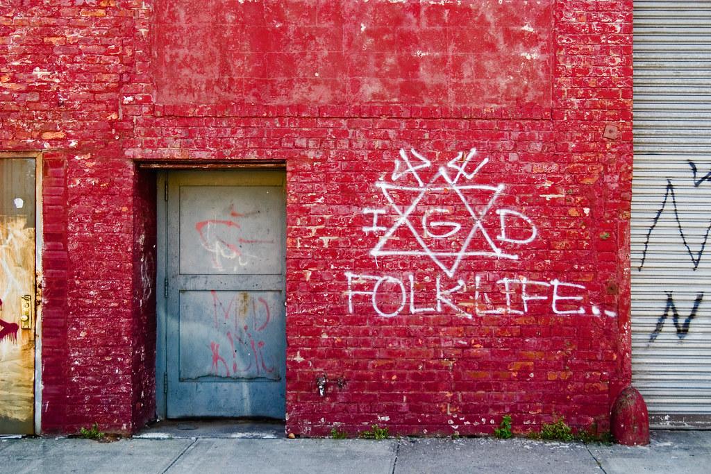 Gang Graffiti   Crip sign on blood red wall  The Folk Nation
