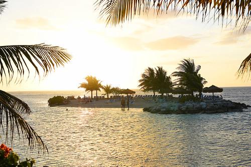 jamaica carribean ocean gulfofmexico sunset beautiful sunny palmtrees island privateisland beach sand people loungechairs rocks water relaxation peaceful sundaylights montegobay tropical